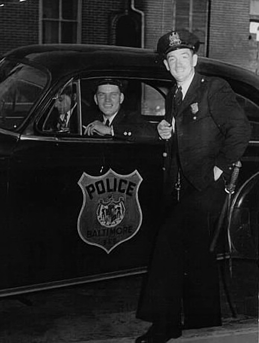 Andrew Vrablic who is sitting in his Police Car in the 1950s