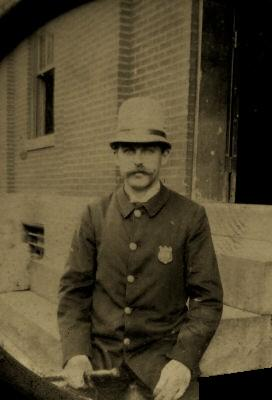 Baltimore_city_patrolman_sitting_on_the_steps_of_the_old_Eastern_district.jpg